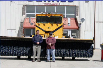 Employees Posing in Front of Machinery