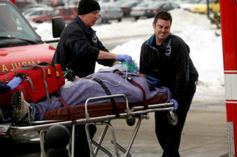 Emergency Medical Services responders care for injured individual on stretcher