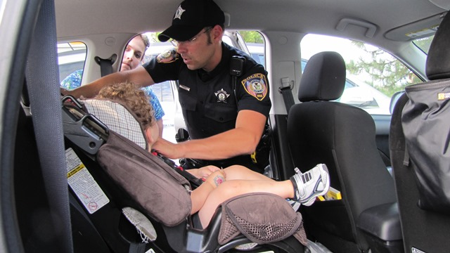 Officer Installing Child Car Seat