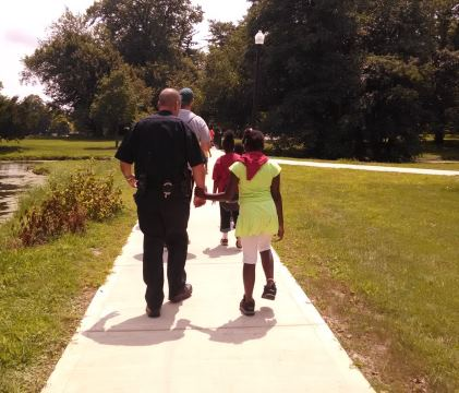 Officer on walk with juvenile